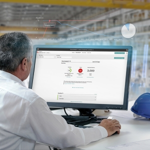 Man works on computer showing yourKONECRANES