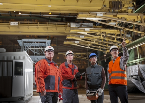 Konecranes experts with customers on-site