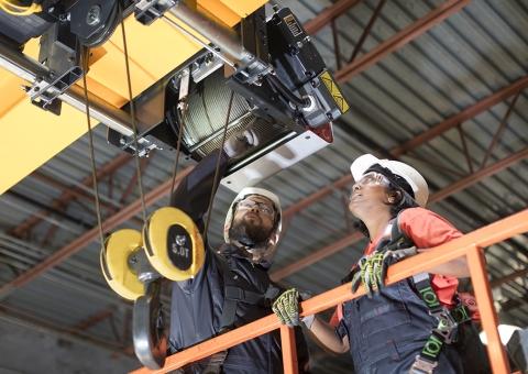 Konecranes service technicians inspecting a crane