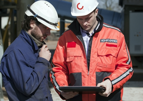 Konecranes technician with customer checking yourKONECRANES