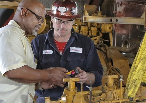 Konecranes technician and customer with crane remote