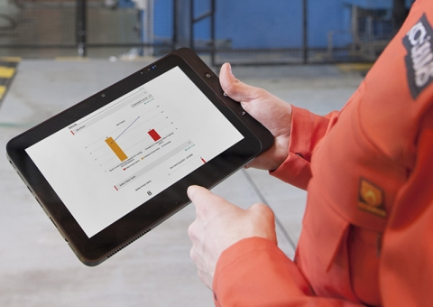 Konecranes technician holds tablet with yourKONECRANES