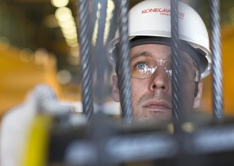 Konecranes technician inspects hoist
