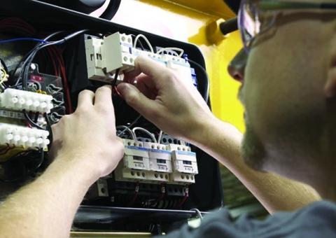 Konecranes technician upgrading VFD