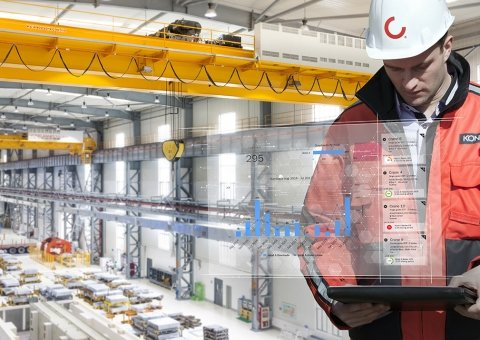 Konecranes technician checks TRUCONNECT data on a tablet