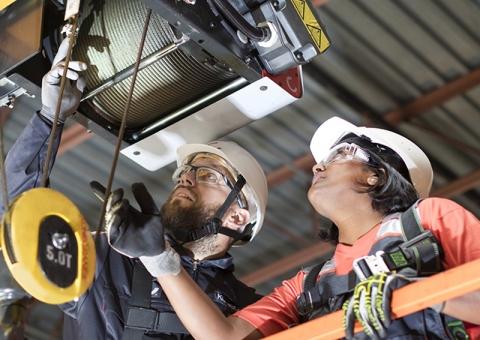 Konecranes technicians inspect a hoist