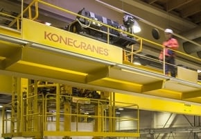 Konecranes technician walks on crane catwalk