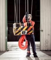 Konecranes technician checks ropes on crane