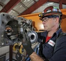 Konecranes technician repairs a hoist
